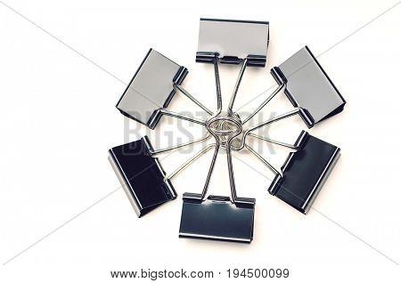 Binder clips on white background