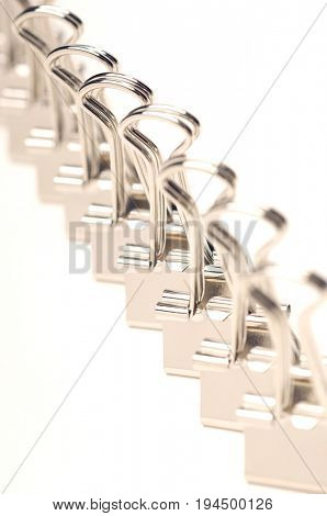 Row of binder clip on white background