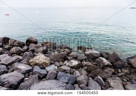 Volcanic Rocks On Waterfront Of Giardini Naxos