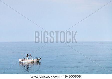 Boat In Ionian Sea In Blue Evening Twilight