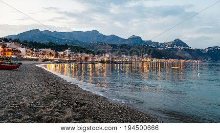 Beach In Giardini Naxos Town In Summer Evening