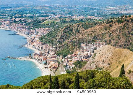 View Of Giardini Naxos Town On Ionian Sea Coast