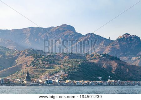 View Of Giardini Naxos Town In Summer Sunset