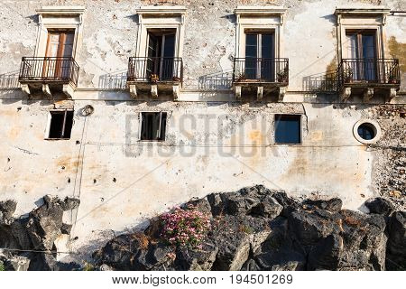 Old House On Volcanic Rock Base In Giardini Naxos