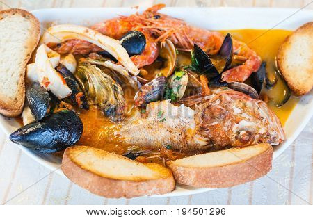 Top View Of Bowl With Fish Soup With Seafood