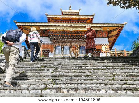 Thimphu Bhutan - September 10 2016: Tourists at the Druk Wangyal Lhakhang Temple Dochula Pass Bhutan. Dochula pass is located on the way to Punakha from Thimphu.