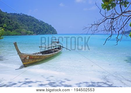 sea beach ship boat long tail boat blue sky at surin island Thailand