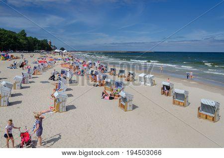 KOLOBRZEG, WEST POMERANIAN / POLAND -  Holiday day on the Baltic Sea beach