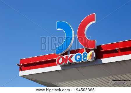 Ornskoldsvik Sweden - June 29 2017: The roof above the gasoline service station OKQ8 with a close-up of the brand name and logo.