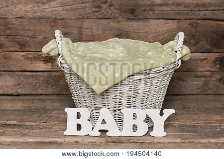 Basket with baby lettering. Dotted pattern towel. Facts about childbirth.