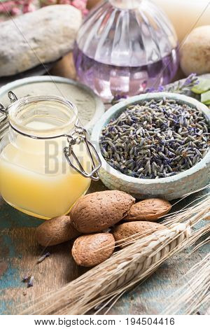 Nature cosmetics handmade preparation with essential oils and ancient minerals of parfums skincare creams soaps from fresh and dried lavender flowers roses wheat almond nuts green clay powder in French artisanal boutique home style