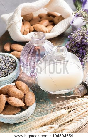 Nature cosmetics handmade preparation of essential oils perfume creams soaps from fresh and dried lavender flowers almond nuts French artisanal boutique home style