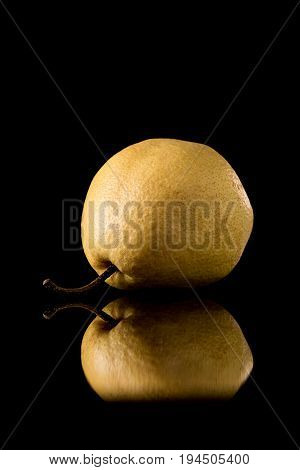 Nashi Japanese Pear  On A Black Reflective Background