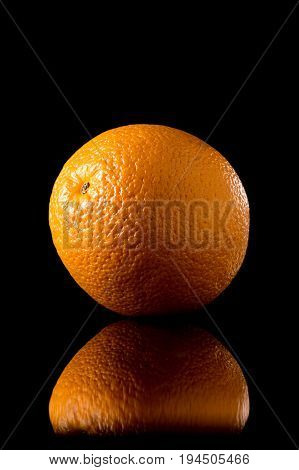 Orange Fruit On A Black Reflective Background