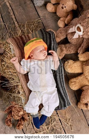 Sleeping child on wooden background. Kid and teddybears.