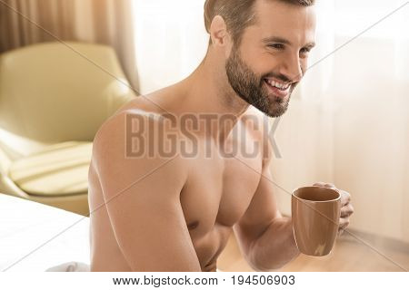 Young male traveler tourist hotel accomodation drinking coffee