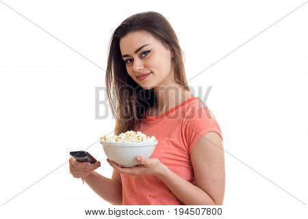 prettty brunette woman watching tv with pop-corn isolated on white background