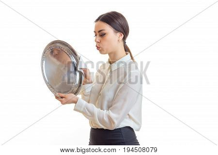 cute brunette waitress with silver trey in hands isolated on white background
