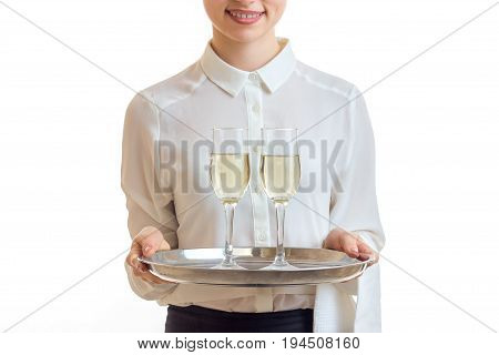 waitress in uniform holding a champagne on silver trey isolated on white background