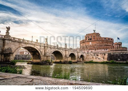 Rome Italy - August 18 2016: Bridge and Mausoleum Castel Sant Angelo at sunset. The Mausoleum of Hadrian usually known as Castel Sant'Angelo is a towering cylindrical building in Rome