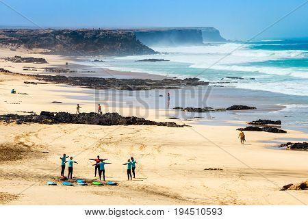El Cotillo Fuerteventura Spain April 03 2017: Unknown kitesurfers on a beach in El Cotillo village in Fuerteventura island Spain