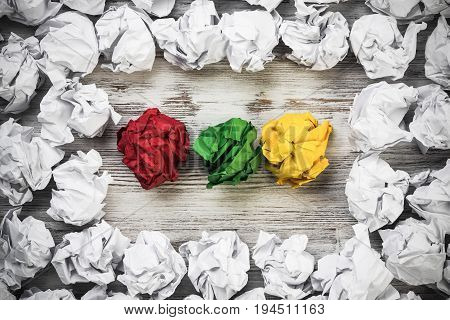 Set of crumpled paper balls with some colorful