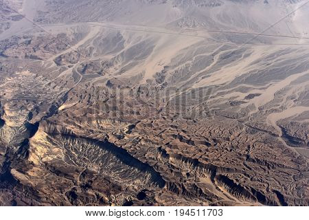 Aerial View Of Desert With Hilly Rugged Terrains