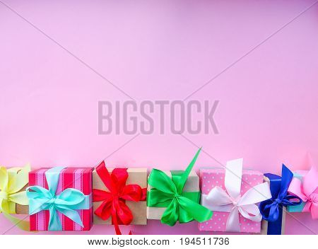 Gift Box With Colorful Satin Ribbon, Pink Background, Greetings On Women's Day, Mother's Day, Valent