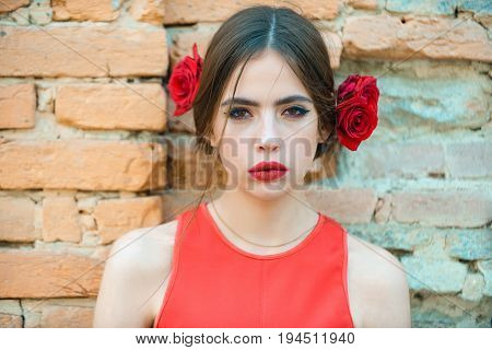 Girl With Red Lips And Fresh Roses In Hair