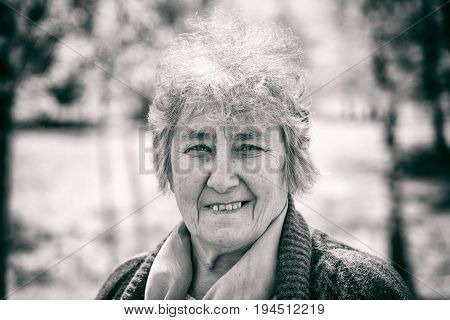 Portrait photo of happy elderly woman smiling for the camera