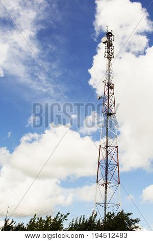 tower of cellular communication. telecommunication tower against the blue sky with clouds. cellular antennas, LTE, GSM, 2G, 3G, 4G, 5G. empty space for your text