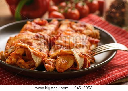 Enchiladas - mexican food, tortilla with chicken, cheese and tomatoes.