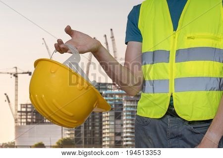 Worker With Protective Helmet On Construction Site..