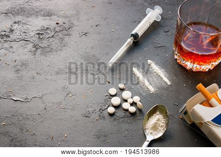 Alcohol In A Glass, Drugs, Syringe, Pack Of Cigarettes On A Black Background With Space For Text. Co