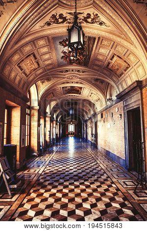 TORRE ALFINA, ITALY. November 8, 2015: Gallery corridor of the castle of Torre Alfina in Italy. Interior corridor design of a castle of fifteen hundred. Castle Tower Alfina, Italy.