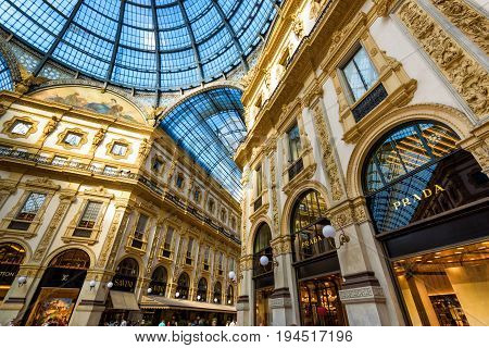 MILAN, ITALY - MAY 16, 2017: Prada stores in the Galleria Vittorio Emanuele II in central Milan. This gallery is one of the world's oldest shopping malls.