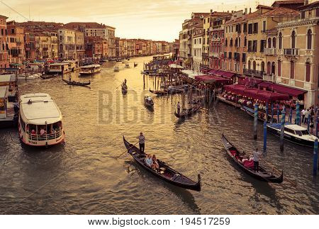 Venice, Italy - May 17, 2017: Grand Canal with gondolas at sunset. Grand Canal is one of the major water-traffic corridors in Venice.