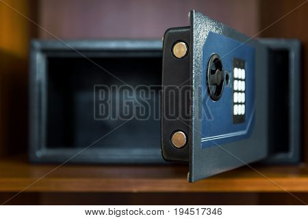 Open empty safe box in hotel room or home. Focus on the lock.