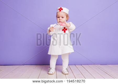 little girl dressed as a doctor plays in hospital 911