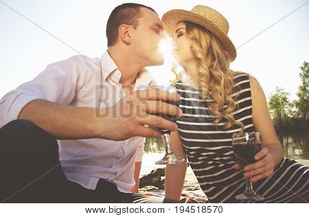 Happy Couple. Low Angle View Of Beautiful Young Woman And Man Keeping Eyes Closed And Sitting Close
