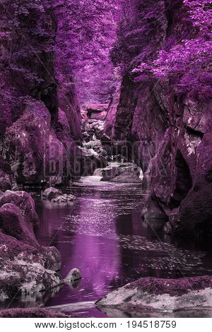 Stunning Ethereal Landscape Of Deep Sided Gorge With Rock Walls And Stream Flowing Through Surreal P