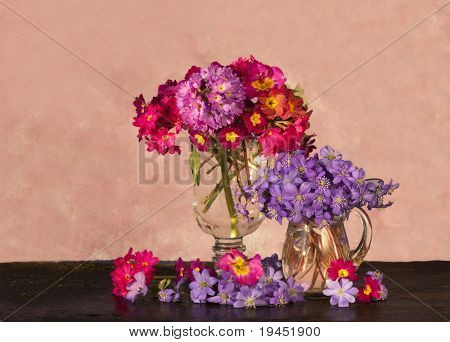 bouquet of flowers in the spring primroses glass pitcher
