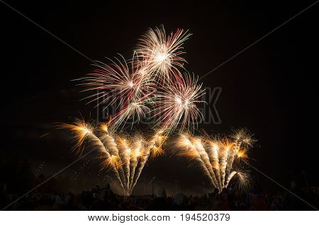Layers Of Bright Orange, Red, Green And White Fireworks