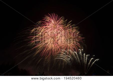 Red, Gold And Silver Fireworks In Dark Night Sky