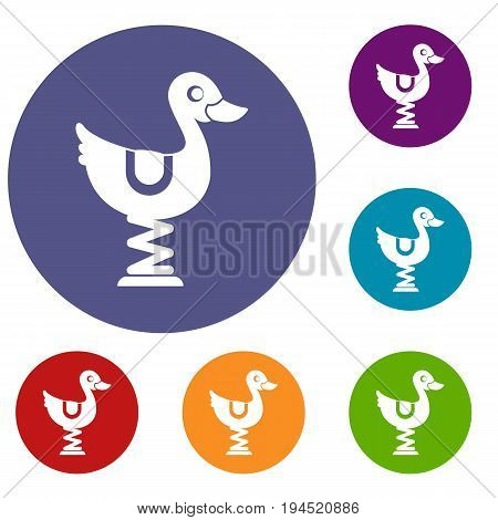 Duck ride in playground icons set in flat circle reb, blue and green color for web