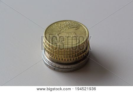 Heap of euro and cents coins on a table