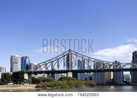 BRISBANE, AUSTRALIA - June 22, 2017: The Story Bridge is the longest cantilever bridge in Australia and spans 777 m over the Brisbane River. Commercial airliner over the Brisbane CBD.