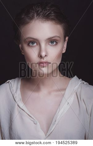 Dramatic Portrait Of A Young Seductive Beautiful Brunette Girl With Short Haircut In The Studio Over