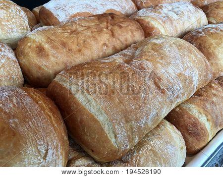 Warm Fresh Breads In A Bakery Shelf Display