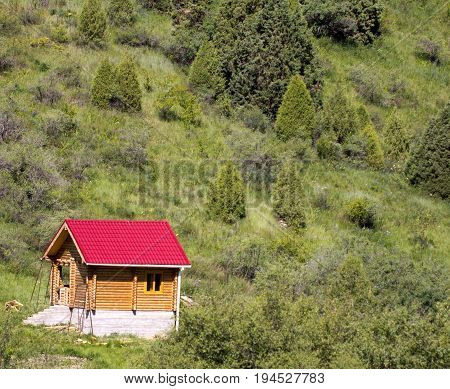 wooden cabin in the mountains of Tien Shan